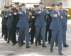Armed Forces  members march during a  Remembrance Day parade from Royal Canadian  Legion No. 7 in Transcona to Blessed Sacrament Church on Roanoke Street.