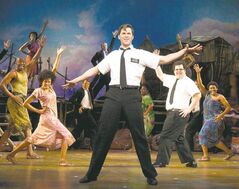 Andrew Rannells, centre, performs with an ensemble cast in The Book of Mormon at the Eugene O'Neill Theatre in New York in a handout photo.