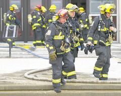 Firefighters were forced to rip up some of the floor at the entrance to the Winnipeg Taxation Centre to get at the fire Saturday morning. No one was injured in the blaze and all tax records and computers were saved from any smoke damage.