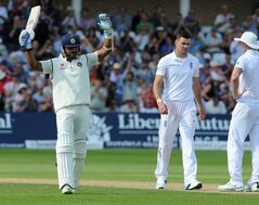 India's Murali Vijay celebrates after scoring a century watched by England's James Anderson, right, during day one of the first Test between England and India at Trent Bridge cricket ground, Nottingham, England, Wednesday, July 9, 2014. (AP Photo/Rui Vieira)