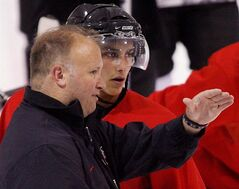Coach Benoit Groulx speaks with Louie Caporusso at the Canadian national junior hockey team development camp in Ottawa on in a July 27, 2008 photo. Hockey Canada announced Thursday that Groulx is back at the helm of the junior team ahead of the World Championships at the end of the year. THE CANADIAN PRESS/Sean Kilpatrick