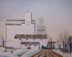 Joel Bouchard's paintings of Manitoba grain elevators are on display at the Tiger Hills Art Gallery in Holland during September.