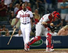 St. Louis Cardinals catcher Yadier Molina (4) pumps his fist after Atlanta Braves left fielder Justin Upton (8) struck out for the final out in the 9th inning of a baseball game Monday, May 5, 2014 in Atlanta. St. Louis won 4-3. (AP Photo/John Bazemore)