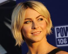 FILE - In this Thursday, Aug. 7, 2014, file photo, actress Julianne Hough looks back for photographers at the premiere of the film