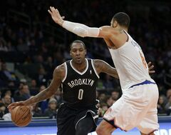 FILE - In this Jan. 20, 2014, file photo, Brooklyn Nets' Andray Blatche, left, tries to move past New York Knicks' Tyson Chandler during an NBA basketball game in New York. The veteran center is an NBA free agent at the moment but currently has a job as the man in the middle for the Philippines, at the FIBA Basketball World Cup. If you're confused, you're far from alone, as how a native of the United States with no ties to the country ended up on their roster is the stuff of international mystery. (AP Photo/Seth Wenig, File)