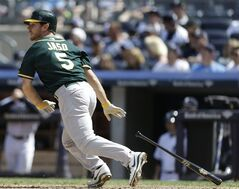 Oakland Athletics' John Jaso (5) runs to first base for a single during the eighth inning of a baseball game against the New York Yankees Thursday, June 5, 2014, in New York. (AP Photo/Frank Franklin II)