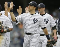 New York Yankees' Mark Teixeira celebrates with teammates after a baseball game against the Tampa Bay Rays Saturday, May 3, 2014, in New York. The Yankees won 9-3. (AP Photo/Frank Franklin II)