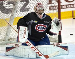 Montreal Canadiens goalie Carey Price makes a glove save during the team's practice Monday, May 5, 2014, in Brossard, Que. The Canadiens play the Boston Bruins in game three of round two of the Stanley Cup Playoffs Tuesday in Montreal. THE CANADIAN PRESS/Ryan Remiorz