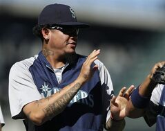 Seattle Mariners pitcher Felix Hernandez walks off the field after the team defeated the Chicago White Sox 4-2 in a baseball game, Sunday, Aug. 10, 2014, in Seattle. Hernandez is scheduled to start against the Toronto Blue Jays on Monday. (AP Photo/Ted S. Warren)