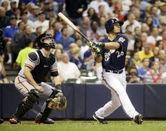 Milwaukee Brewers' Gerardo Parra hits a home run during the seventh inning of a baseball game against the San Francisco Giants Tuesday, Aug. 5, 2014, in Milwaukee. (AP Photo/Morry Gash)