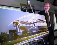 Murray Taylor, president and CEO of Investors Group, at the news conference Wednesday with an illustration showing the new stadium with name.