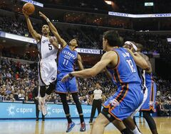 Memphis Grizzlies forward Courtney Lee shoots against Oklahoma City Tuesday, Jan. 14, 2014, in Memphis, Tenn. Th THE CANADIAN PRESS/AP, Lance Murphey