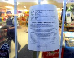 An eviction notice is displayed at the Red Sun Smoke Shop & Gas Bar.