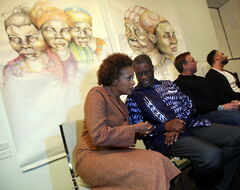 Michaelle Jean and Dr. Denis Mukwege chat while attending the opening of the exhibit, Peace Should Not Be This Fragile, at the Graffiti Gallery Wednesday.