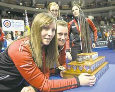 Ontario�s skip Rachel Homan (from left) third Emma Miskew, second Alison Kreviazuk and lead Lisa Weagle show off the hardware Sunday.