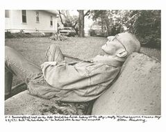 Author William Burroughs sits at rest in the side-yard of his house in Lawrence, Kansas, in 1991.
