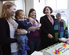 At the cake cutting ceremony today to mark the first year anniversary of the Birth Centre were Sara Heinrichs with Jack, the first child born at the centre (from left), Leslie Hall, with daughter Alivia, the 100th baby born at the centre, Health Minister Theresa Oswald and Executive Director Joan Dawkins.
