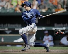 Tampa Bay Rays' Brandon Guyer follows through on a double against the Baltimore Orioles in the eighth inning of a baseball game Friday, June 27, 2014, in Baltimore.(AP Photo/Gail Burton)