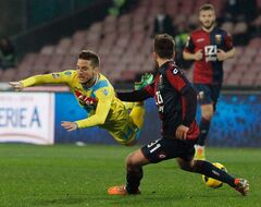 Napoli's Dries Mertens, left, and Genoa's Andrea Bertolacci vie for the ball during a Serie A soccer match between Napoli and Genoa, at the San Paolo stadium in Naples, Italy, Monday, Feb, 24, 2014. (AP Photo/Pressphoto)