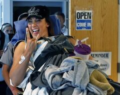 ADVANCE FOR WEEKEND EDITIONS, JUNE 28-29 - FILE - In this June 18, 2014 file photo, six-time Olympic gold medal swimmer Amy�Van�Dyken-Rouen smiles and gestures as she is transferred to her room after arriving at Craig Hospital, in Englewood, Colo. (AP Photo/Brennan Linsley, File)
