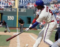 Philadelphia Phillies' Domonic Brown strikes out swinging to end the eighth inning of a baseball game against the Atlanta Braves, Sunday, June 29, 2014, in Philadelphia. The Braves won 3-2. (AP Photo/Tom Mihalek)