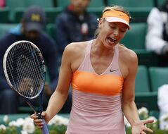 Russia's Maria Sharapova reacts as she plays Australia's Samantha Stosur during their fourth round match of the French Open tennis tournament at the Roland Garros stadium, in Paris, France, Sunday, June 1, 2014. (AP Photo/Darko Vojinovic)