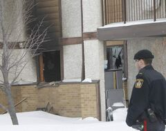 Police officers were at the scene of a fire that was extinguished in a main floor suite in the Linden Woods Village Tuesday afternoon.