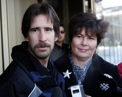Kyle Unger and his mother, Treva Unger, speak to reporters outside the Law Courts in Winnipeg Wednesday, the day his conviction for first-degree murder in the 1990 death of Brigitte Grenier was quashed.