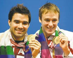 Canada's Alexandre Despatie (left) and Reuben Ross display their gold medals in New Delhi, India on Tuesday.