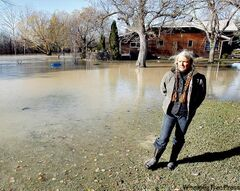 'This is stuff that can't wait. As soon as the ice is off that lake, we're done' — Ann Cook, shown on her property after last fall's 'weather bomb'