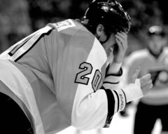 Philadelphia Flyer Chris Pronger takes a stick in the face in October 2011.