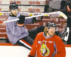Ottawa Senators Jason Spezza hops the boards to join teammate Daniel Alfredsson during practice in Ottawa Sunday. The Sens will face Pittsburgh in Round 2.