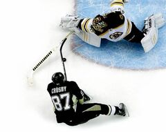 Pittsburgh Penguins center Sidney Crosby can't get a shot past Boston Bruins goalie Tuukka Rask during the first period of an NHL hockey game in Pittsburgh March 17, 2013. The Penguins won 2-1.
