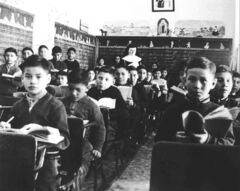 Students in class at St. Joseph's Residential School in Cross Lake in 1951. Accusers claim Indian residential schools meet the United Nations Genocide Convention's fifth clause: forcibly transferring children of the group to another group.