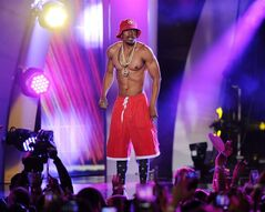 Nick Cannon performs in Miami, Fla., June 28, 2014. Cannon is heading to Toronto to host a free outdoor afternoon concert this summer. THE CANADIAN PRESS/AP/Jeff Daly/Invision/AP