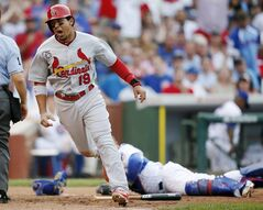 St. Louis Cardinals' Jon Jay reacts after scoring past Chicago Cubs catcher Welington Castillo, rear, during the seventh inning of a baseball game on Saturday, July 26, 2014, in Chicago. (AP Photo/Andrew A. Nelles)