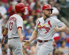 St. Louis Cardinals' Matt Carpenter, left, and Matt Holliday, right, celebrate after scoring on Matt Adams' two-run triple against the Chicago Cubs during the seventh inning of a baseball game on Saturday, July 26, 2014, in Chicago. (AP Photo/Andrew A. Nelles)