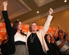NDP candidate Catherine Fife and leader Andrea Horvath celebrate their win with supporters in a Ontario provincial by-election in the Kitchener-Waterloo riding in Kitchener-Waterloo, Ontario, Thursday, September 6, 2012. THE CANADIAN PRESS/Dave Chidley