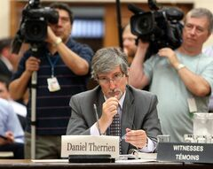 Privacy Commissioner Daniel Therien prepares to appear at Commons Human Rights committee on Parliament Hill in Ottawa, Tuesday June 10, 2014. THE CANADIAN PRESS/Fred Chartrand