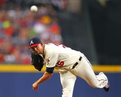 Atlanta Braves starting pitcher Mike Minor (36) delivers in the first inning inning of a baseball game against the Los Angeles Angels, Sunday, June 15, 2014, in Atlanta. (AP Photo/Todd Kirkland)