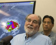 Hawaii Gov. Neil Abercrombie, center, speaks at the National Weather Service office on the campus of the University of Hawaii, Thursday, Aug. 7, 2014, in Honolulu. Hawaii is bracing for both Hurricane Iselle and Julio which are on course to hit the Hawaiian Islands. (AP Photo/Marco Garcia)