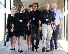 The Archbishop of Canterbury, Justin Welby, second right, and unidentified members of the clergy, arrive for the General Synod meeting, at The University of York, in York England, Monday July 14, 2014. The Church of England is set to vote on whether women should be allowed to enter its top ranks as bishops. The Church's national assembly, known as the General Synod, is meeting in York, northern England, where it will debate the issue ahead of a vote Monday. (AP Photo/PA, Lynne Cameron) UNITED KINGDOM OUT NO SALES NO ARCHIVE
