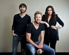 FILE - This March 22, 2013 file photo shows members of Lady Antebellum, from left, Dave Haywood, Charles Kelley and Hillary Scott in Nashville, Tenn. The title for Lady Antebellum's forthcoming new album,