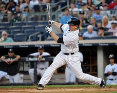 New York Yankees' Brian McCann follows through on an RBI double off of Cincinnati Reds starting pitcher Mike Leake in the first inning of an interleague baseball game at Yankee Stadium on Friday, July 18, 2014, in New York. (AP Photo/Kathy Kmonicek)