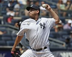 New York Yankees starting pitcher Vidal Nuno (57) delivers in the third inning of a baseball game against the Tampa Bay Rays at Yankee Stadium in New York, Wednesday, July 2, 2014. (AP Photo/Kathy Willens)
