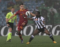 Roma's Erik Lamela, left, and Udinese's Emmanuel Badu, challenge for the ball during the Serie A soccer match between Udinese and Roma, at the Friuli Stadium in Udine, Italy, Saturday, March 9, 2013. (AP Photo/Paolo Giovannini)