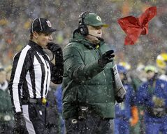 Head linesman Kent Payne (79) watches as Green Bay Packers head coach Mike McCarthythrows his challenge flag during the second half of an NFL football game against the Pittsburgh Steelers Sunday, Dec. 22, 2013, in Green Bay, Wis. The play was reversed and the Packers were credited with a fumble recovery. (AP Photo/Morry Gash)