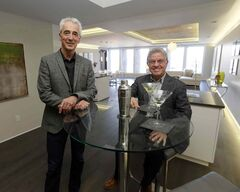 Tom Hayward (left) and Gary Bachman in a suite in Dreman Place. They're bullish on downtown condos.