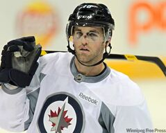Winnipeg Jets captain Andrew Ladd (16) wears a visor during practice before the game tonight at the MTS Centre.