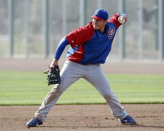 Chicago Cubs first baseman Anthony Rizzo (44) throws the ball to second base during spring training baseball practice, Friday, Feb. 21, 2014, in Mesa, Ariz. (AP Photo/Rick Scuteri)